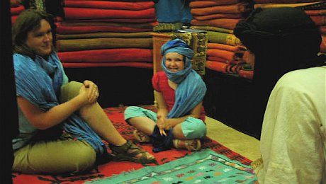 Family-holiday-Morocco-haggling-carpets